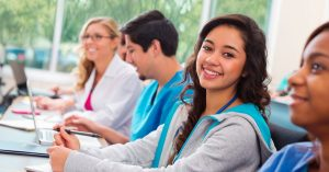 Smiling college students in classroom