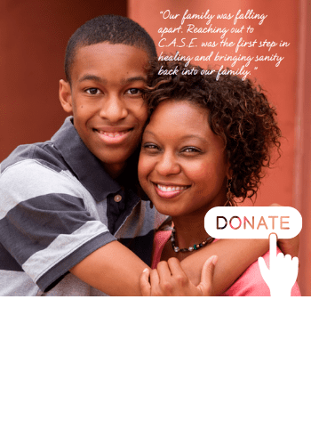 Black Mom & Black Son Hugging